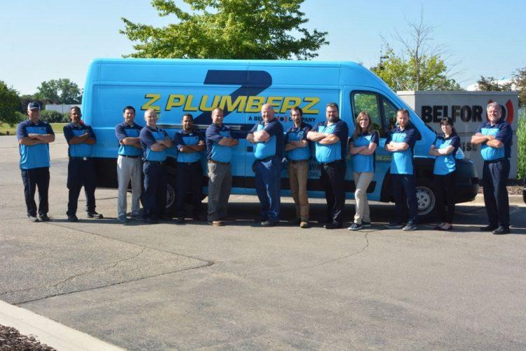 Z PLUMBERZ team standing in front of the van