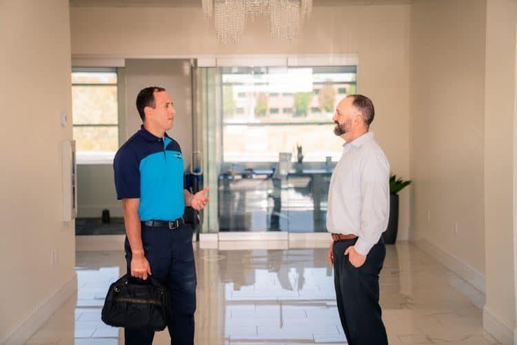 Z PLUMBERZ tech speaking to a customer